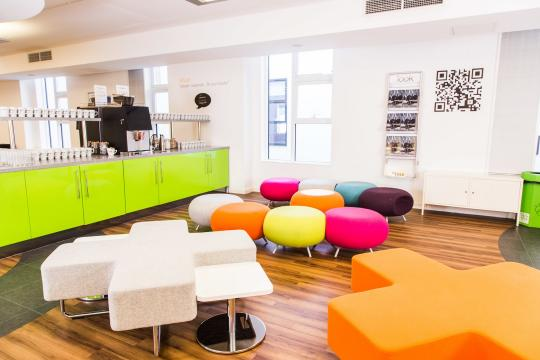 interior of thestudio Manchester with colourful seats and refreshment station in background